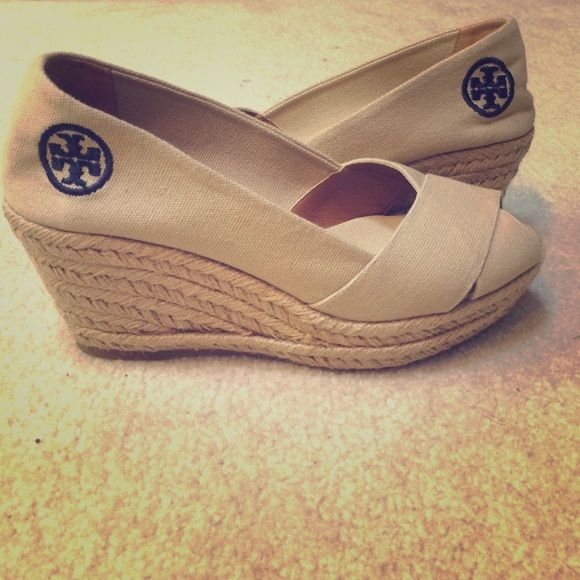 Tory Burch Criss Cross wedge espadrille! For sale are Tory Burch Criss cross wedge espadrilles. They are VERY HARD TO FIND due to them being sold out almost everywhere online.  They are kaki with the navy Tory Burch logo. They are size 7.  Feel free to ask questions and make offers. No box but guaranteed 100% authentic! Tory Burch Shoes Espadrilles