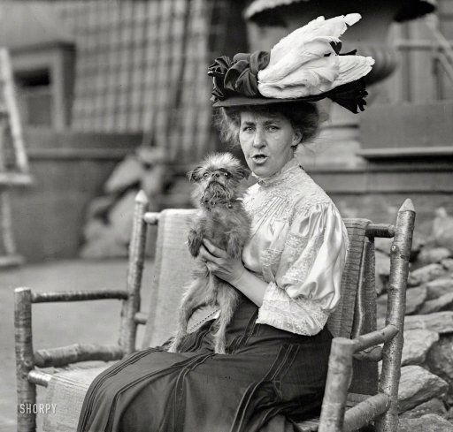 What a fabulously ugly dog! New York circa 1908. Mary Langley Bruce seated with her Griffon Bruxellois, 'Cupid'. 5x7 glass negative, Bain News Service.