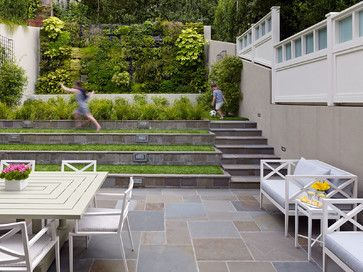 love this terracing -- instant built-in flex seating. Also the green garden wall.