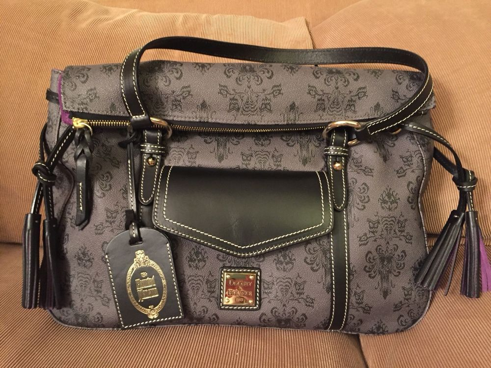 db67560ae1e Brand new with tags Dooney   Bourke Satchel Bag. Haunted Mansion wallpaper  print. Purse style is Smith. Coveted purple lining. Two sets of black  tassels ...