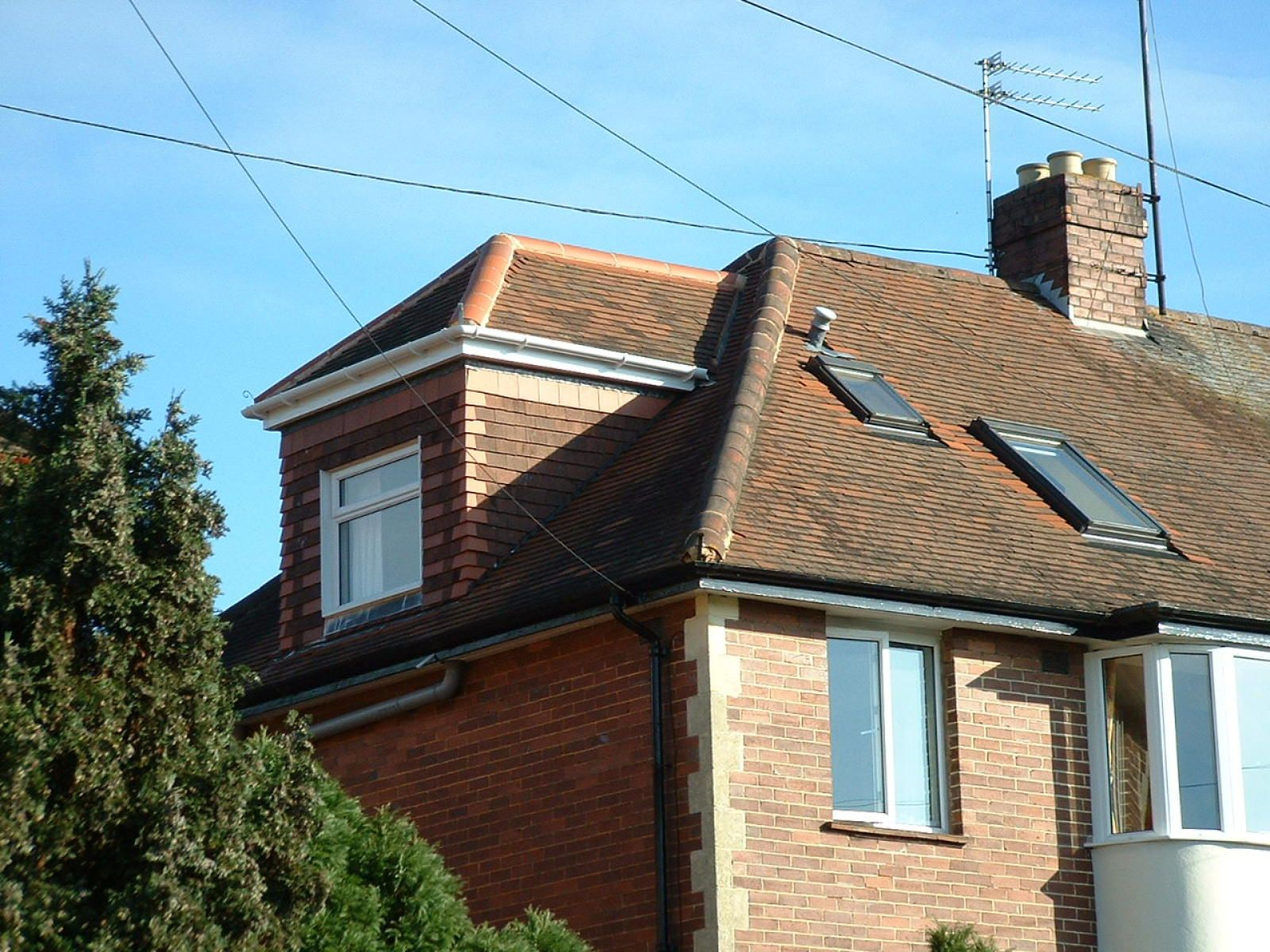 Pitched roof dormer by attic designs ltd upstairs 702 for Roof dormer design plans