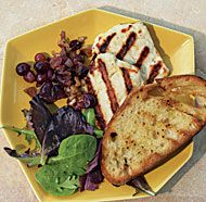 Halloumi, a goat and sheep's milk cheese from Cyprus, is perfect for grilling: It softens over the heat but doesn't melt. This cheese plate, complete with grilled grapes and rustic bread,is an elegant way to start off a special-occasion meal, or it can be the meal itself with a green salad.