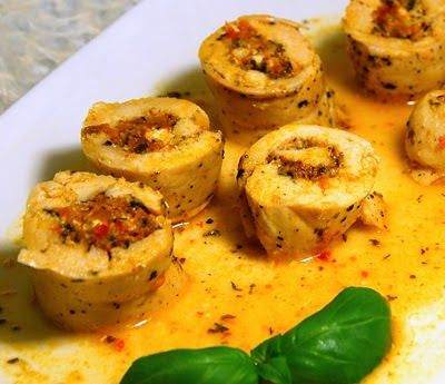 poached chicken breast stuffed with goat cheese and sun-dried tomato pesto