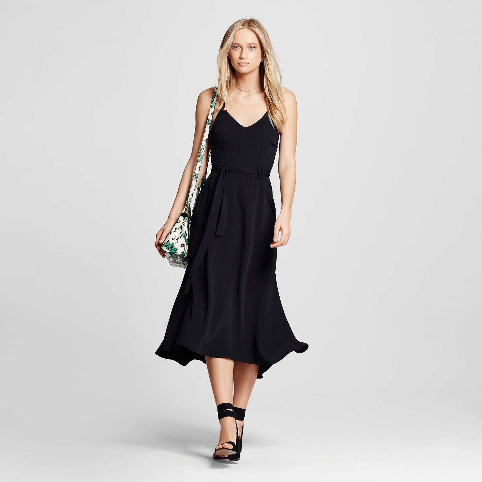 The Utility Midi Dress - Who What Wear™ offers the look of a slip dress, given stylish structure with the simple addition of pockets and a belted waistline. Super-versatile by design, our slim-cut dress layers easily over tees and long-sleeve tops; midi length is great with everything from sandals to sneakers to booties.
