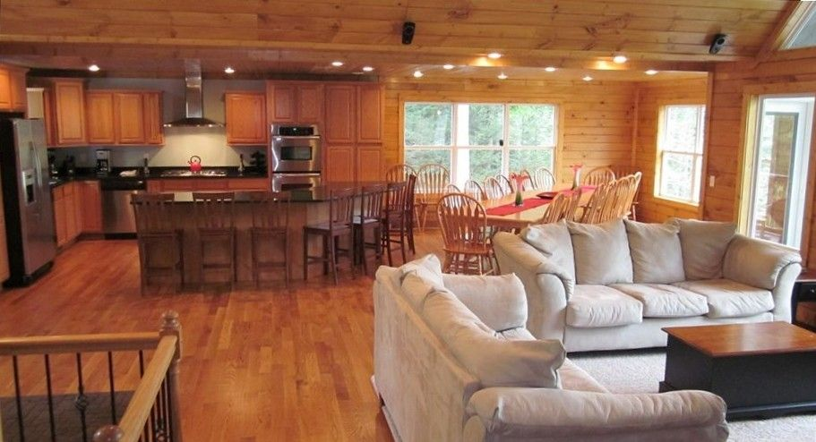 Open floor plan with 20-person dining room table and 10 ...