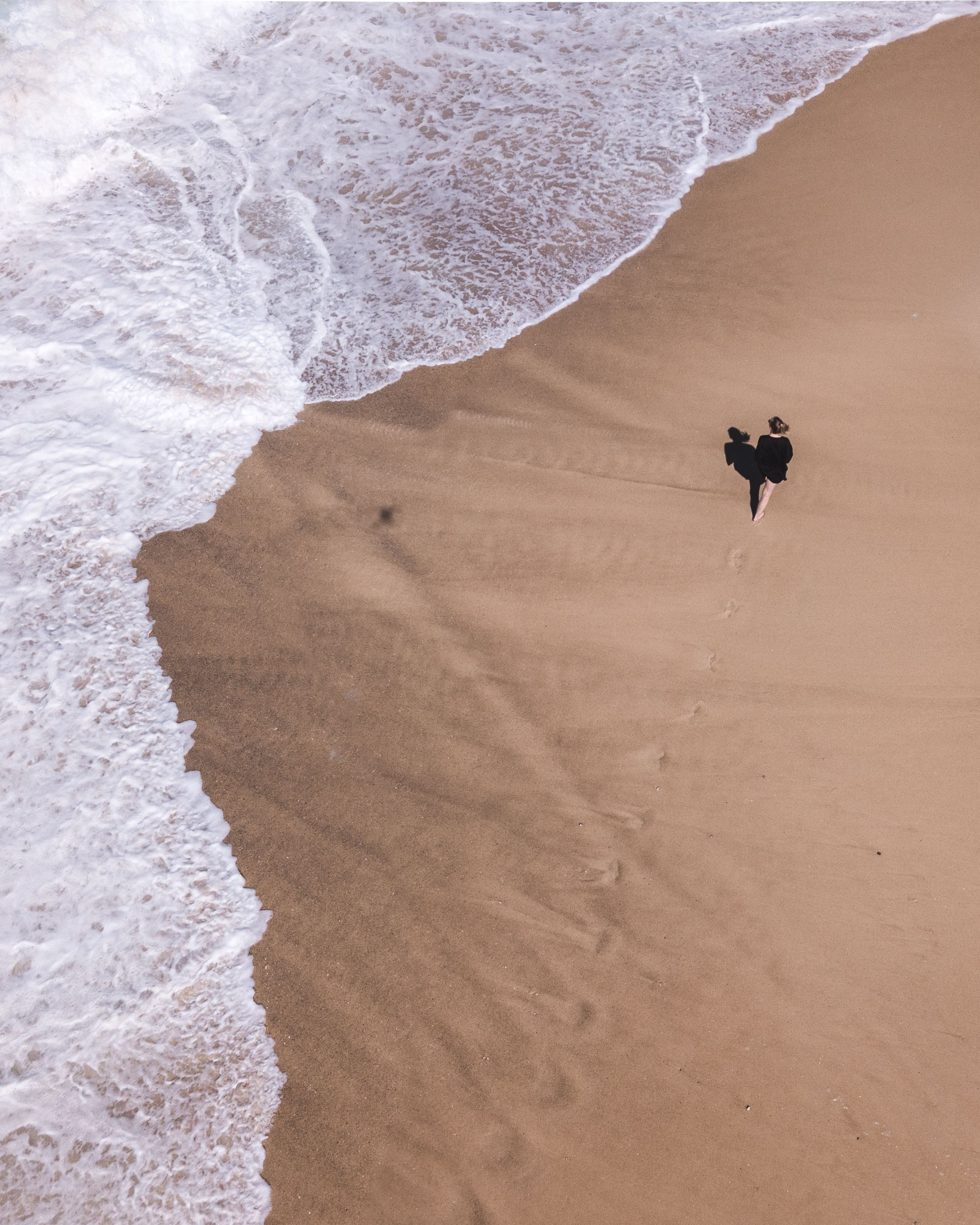 Drone Shot Of Woman Walking On A Beach Drone Photos Photo Video Mockup