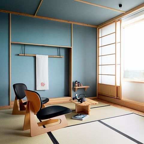 Traditional Japanese decoration is paired with raw concrete and pine