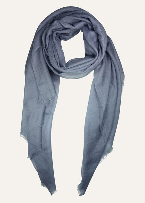 This mineral toned cashmere scarf by Ezma is woven from ultra fine cashmere and features a one inch wispy fringe. 100% cashmere. Made in India.
