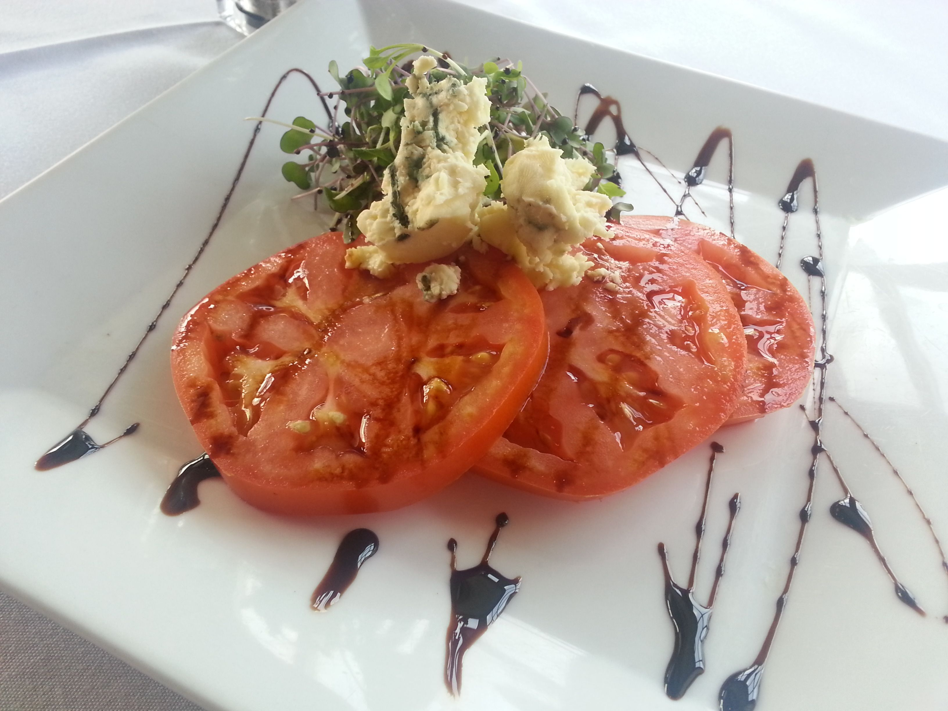 Beef steak tomato with micro greens crumbled