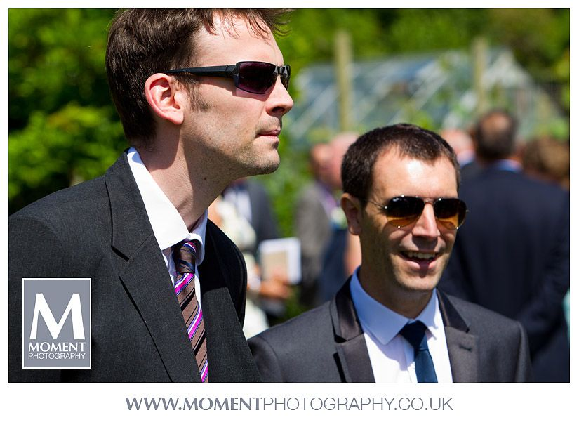 Candid photo of wedding guests at Adam & Helen's wedding at Gants Mill, Bruton, Somerset. www.gantsmill.co.uk