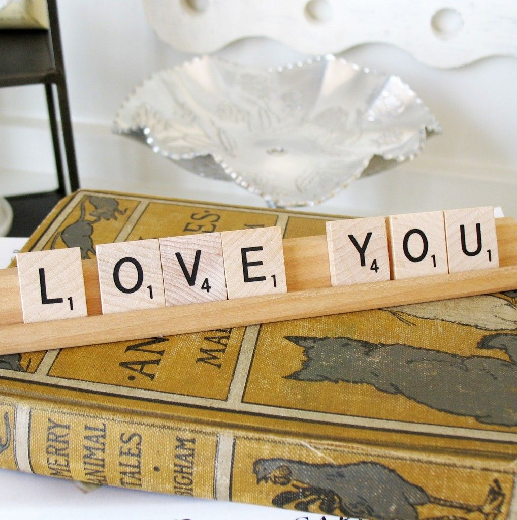 decorate with scrabble tiles---change them up whenever you want... I'm for sure doing this!