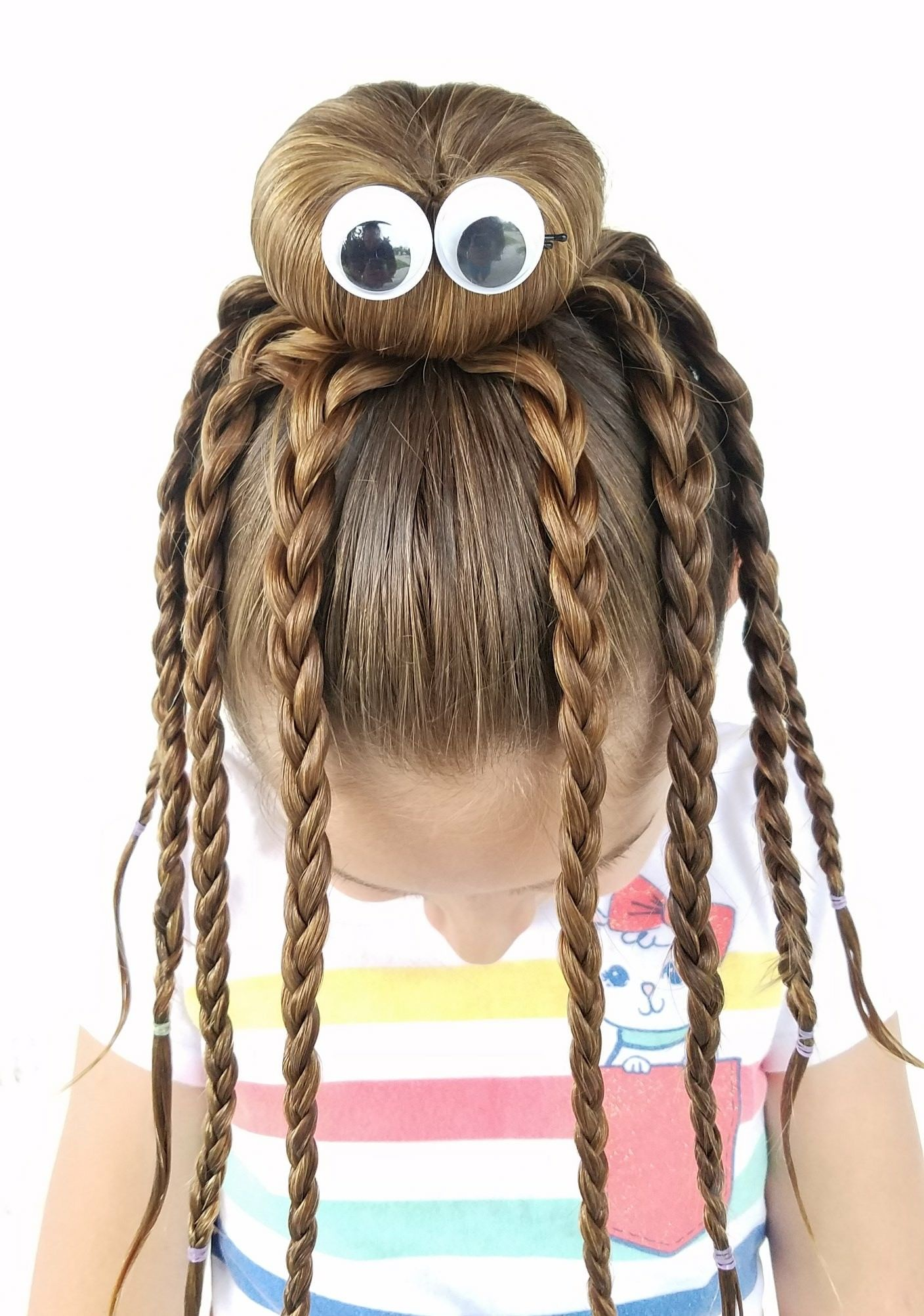 We had fun creating this octopus bun hairstyle with my daughter. With school starting up, I thought some of you could use some inspiration for crazy hair day.