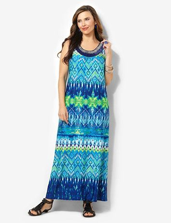 Our new maxi dress promises bold beauty with every wear. Silky, stretch style comes in a mixed print of vibrant colors and geometric designs. Two-tone beads add a tribal look to the scoop neckline. Sleeveless piece has an easy, pull-on design and pairs perfectly with any of our soft shrugs. Catherines dresses are expertly designed for the plus size woman catherines.com
