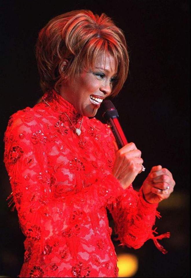 Whitney Houston performs at the Trump Taj Mahal in 1998.