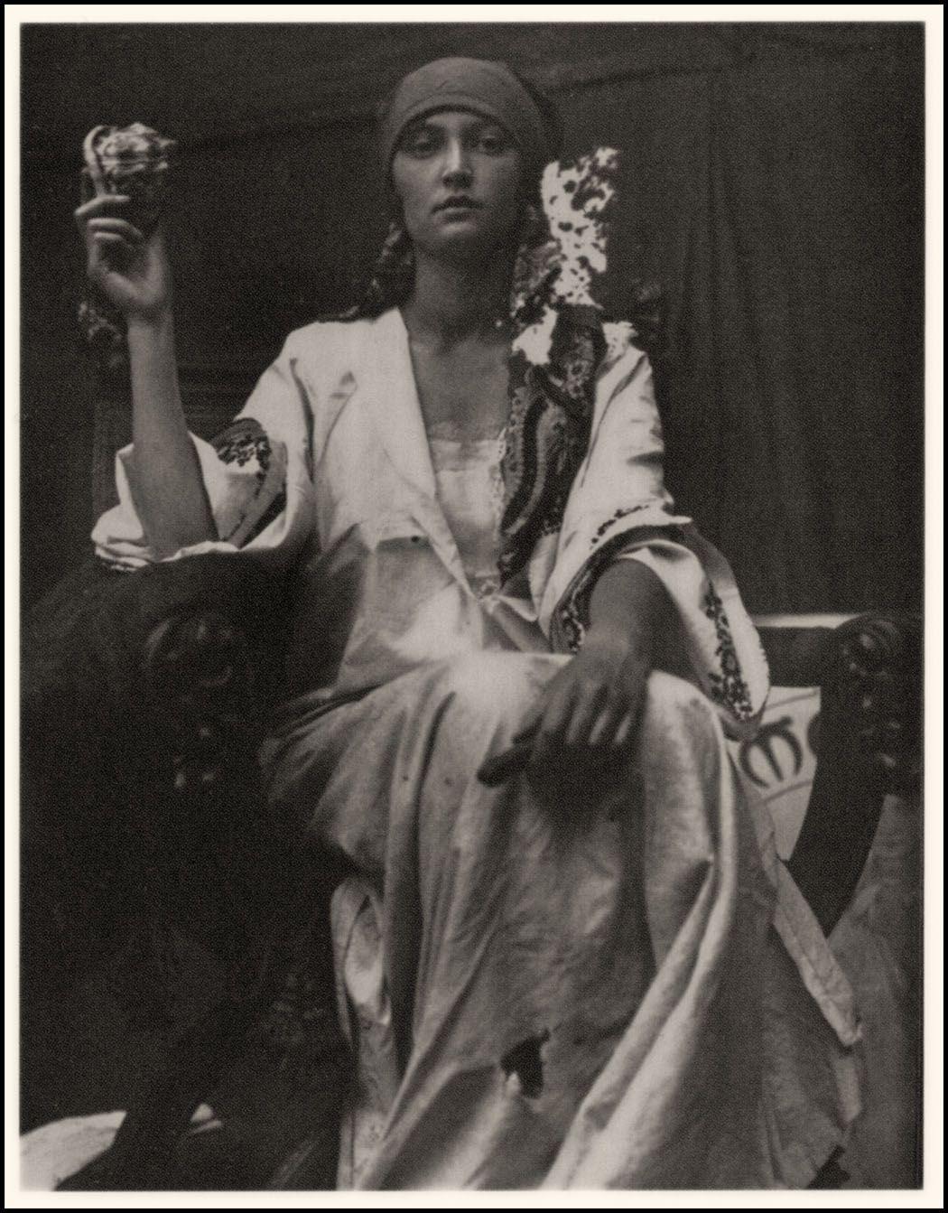 Alphonse Mucha. model. 1919. black and white photograph.