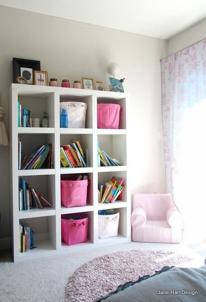 Ikea Expedit shelving utilizes vertical space and allows for flexible storage. There's still room for art above this shelving unit! It may be possible to add Ikea legs to this too.