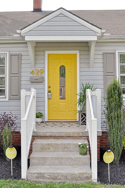 Grey house grey shutters yellow door exterior for Front door yellow house