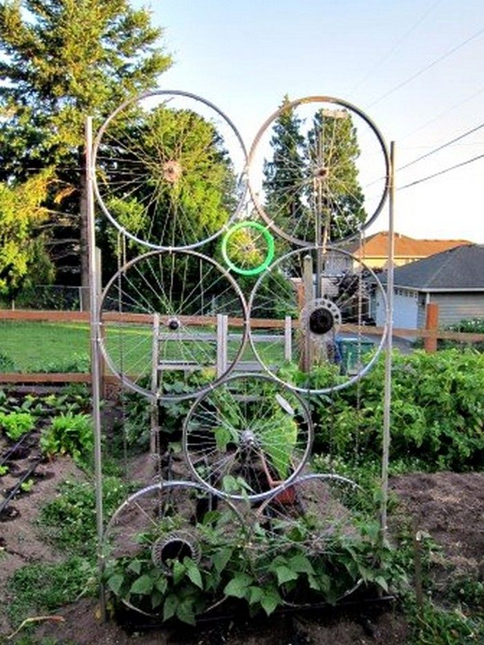 Garden trellis from old bike tires upcycling ideas gardens and a great upcycling idea using old bike wheels workwithnaturefo