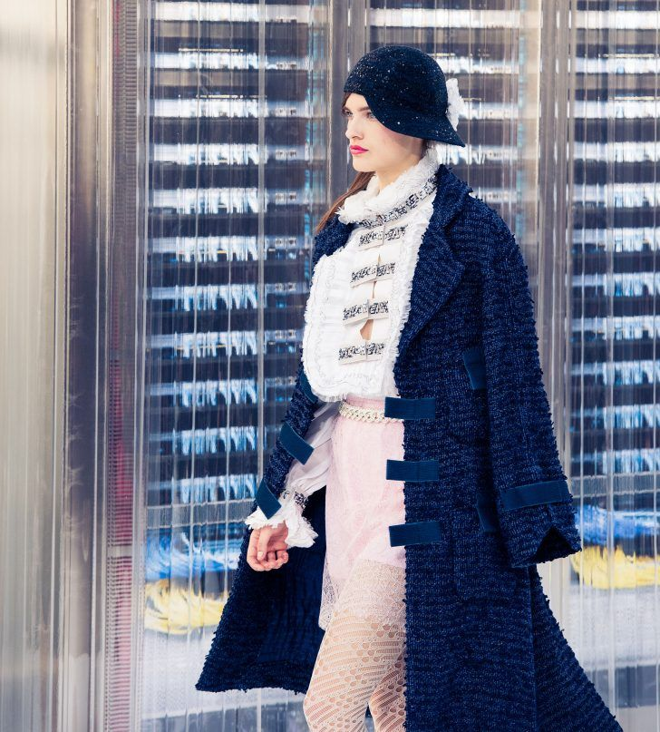 Inside Chanel's Spring 2017 Paris Fashion Week Show: Light Pink Skirt with embellished white blouse and a navy blue tweed jacket | coveteur.com