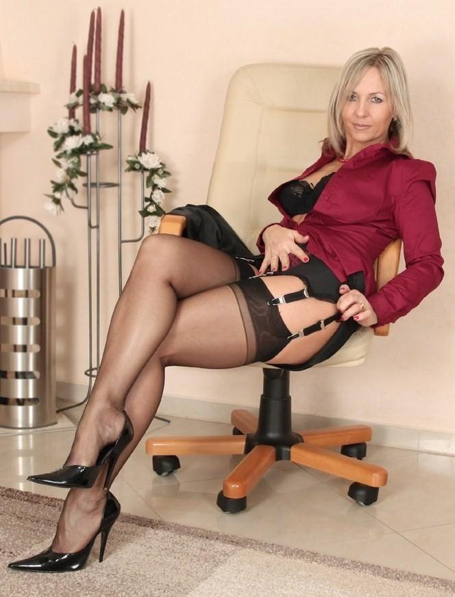 Older women in mini dress, high heels tights