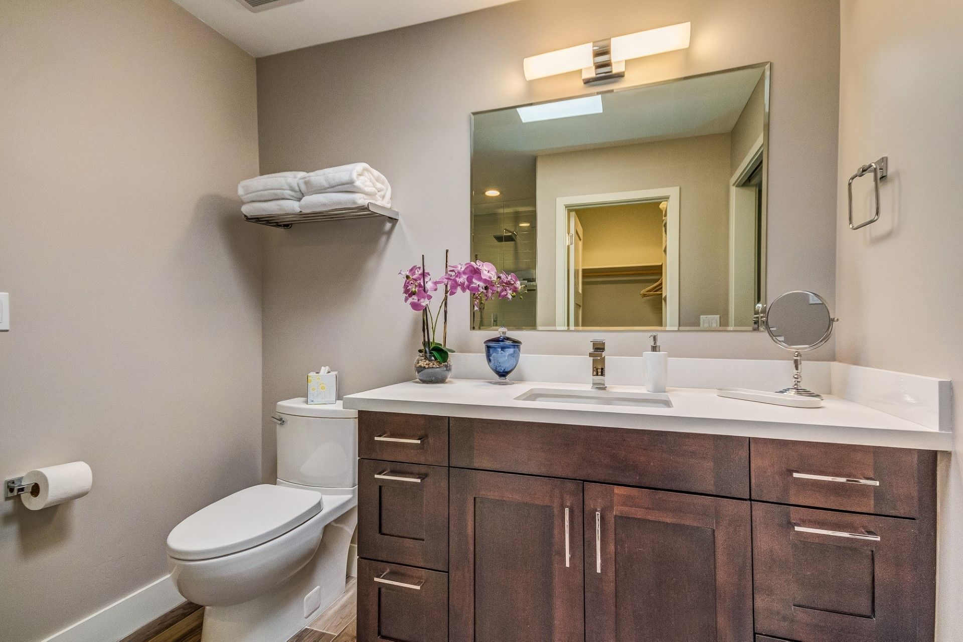 Here In The Guest Bathroom At San Carlos Has The Same Stained Cabinets That Match The Kitchen Is Kitchen Remodeling Companies Staining Cabinets Modern Hardware