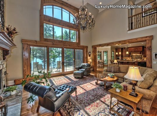 Expansive living room with beautiful chandelier and large windows