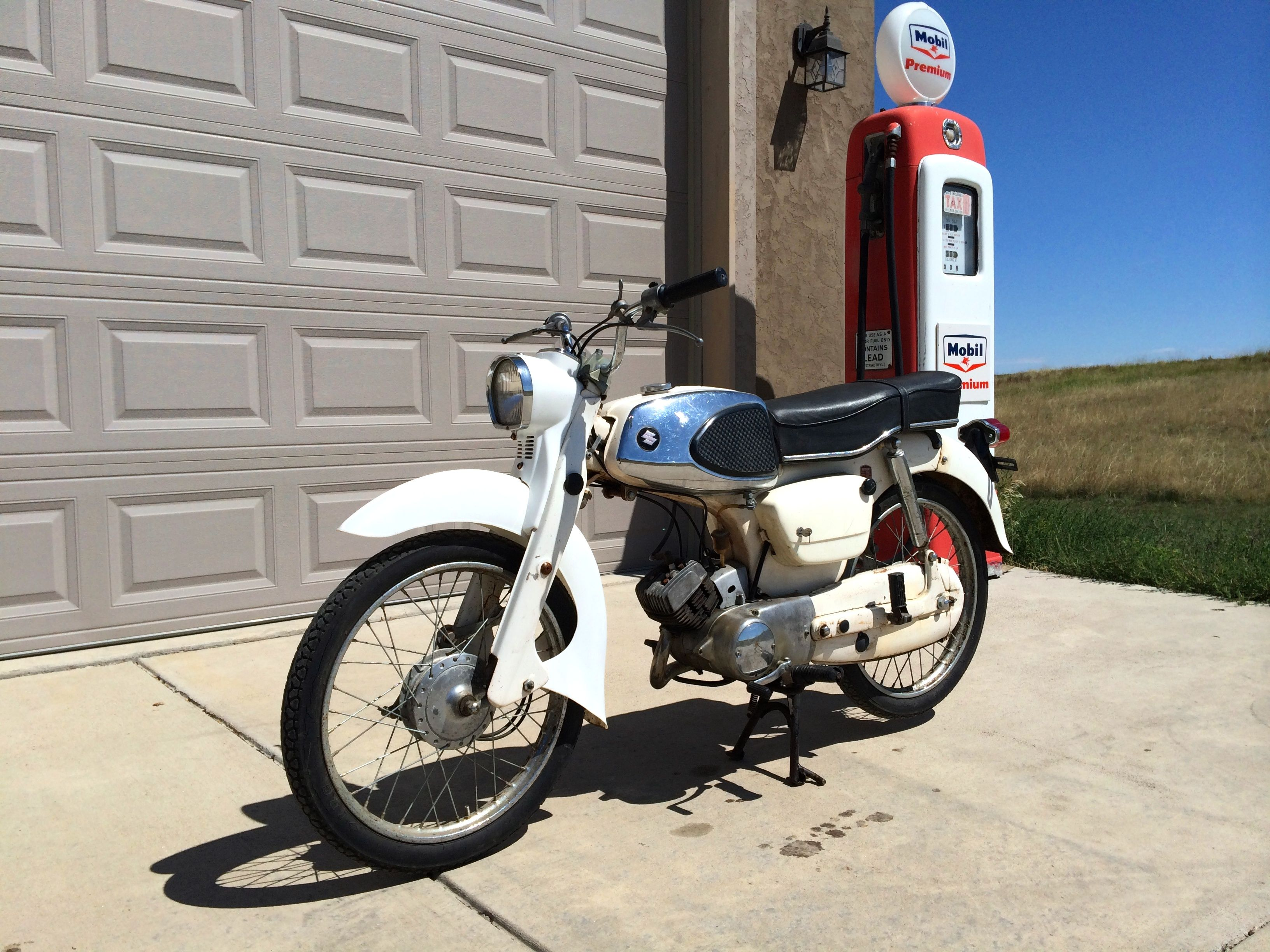 "1964 Suzuki ""Collegian"" 50cc Sport Standard, Model MD. 4 speed manual  transmission. Forks have leading link suspension."