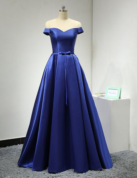b0d89b09e5e Royal Blue Satin Floor Length A-Line Prom Dress Featuring Off Shoulder  Bodice with Bow Accent Belt and Lace-Up Detailing