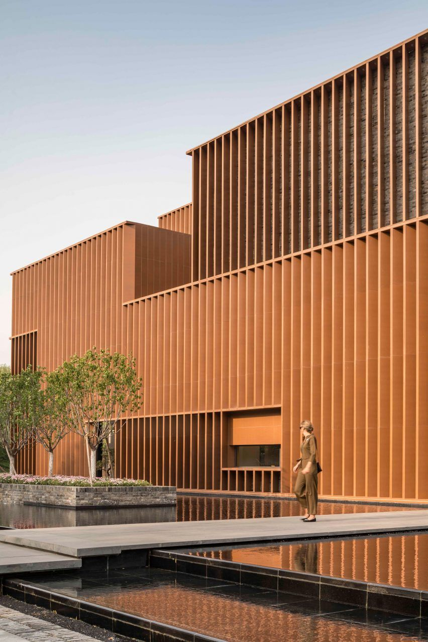 Angled Aluminium Louvres Cover The Reclaimed Brick Walls Of The Junshan Cultural Center Near Beijing China Desig In 2020 Architecture Neri And Hu Modern Architecture