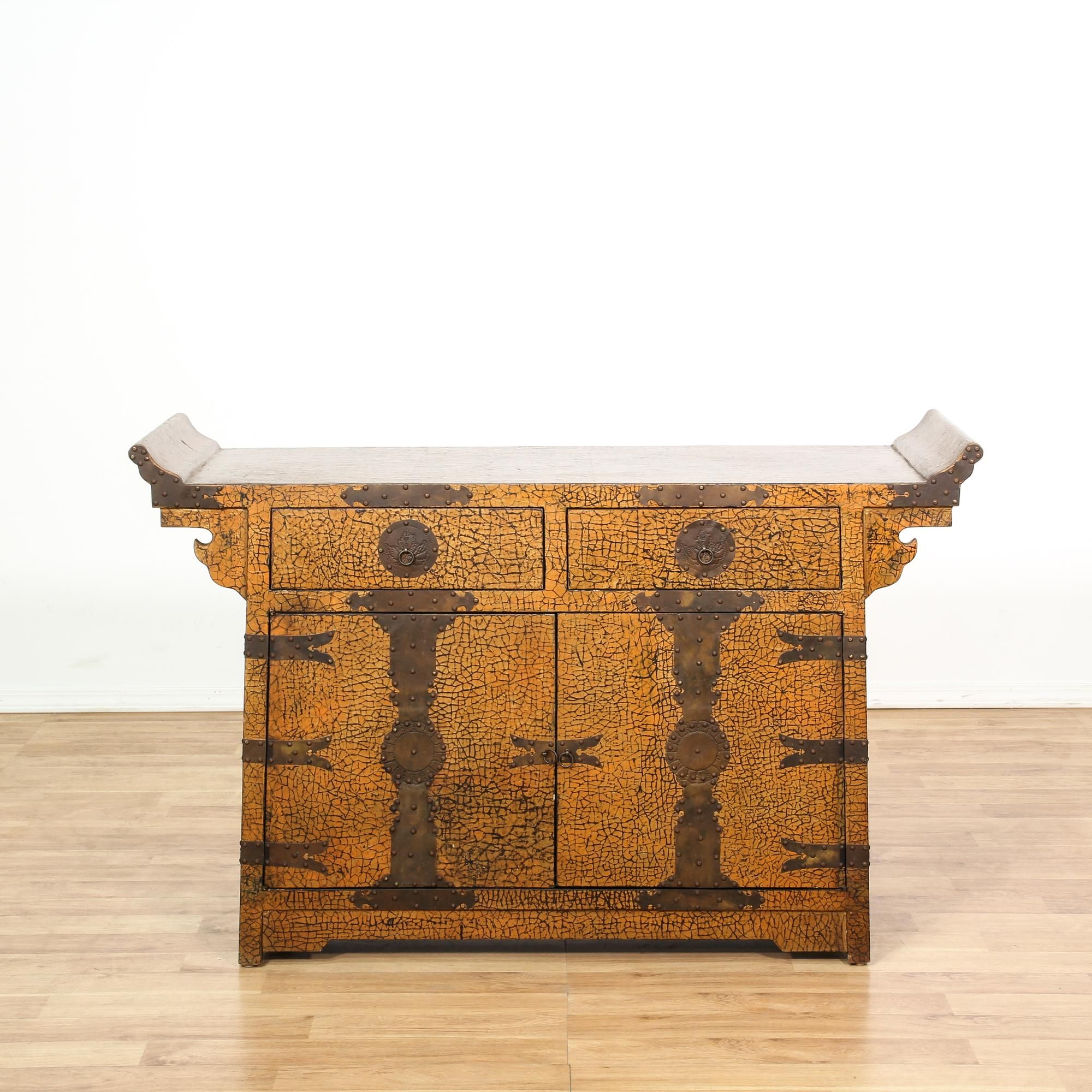 This asian buffet cabinet is featured in a solid wood with a ...