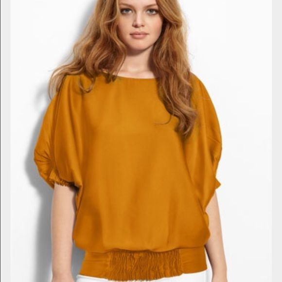 Diane Von Furstenberg Silk Tunic Blouse Details: Diane von Furstenberg silk tunic top. Short batwing sleeves with pleated elastic/stretch cuffs. Pleated detail at front and back and at sleeves. COLOR: Gold Mustard silk Diane von Furstenberg Tops Blouses