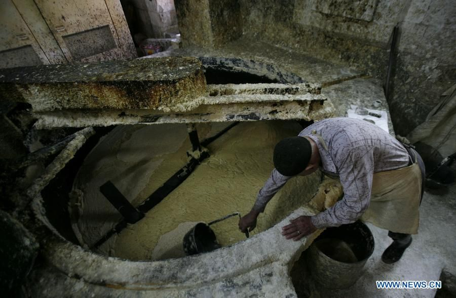 A Palestinian worker lines up soap pieces at the Touqan factory in the West Bank city of Nablus, on Oct. 8, 2012.