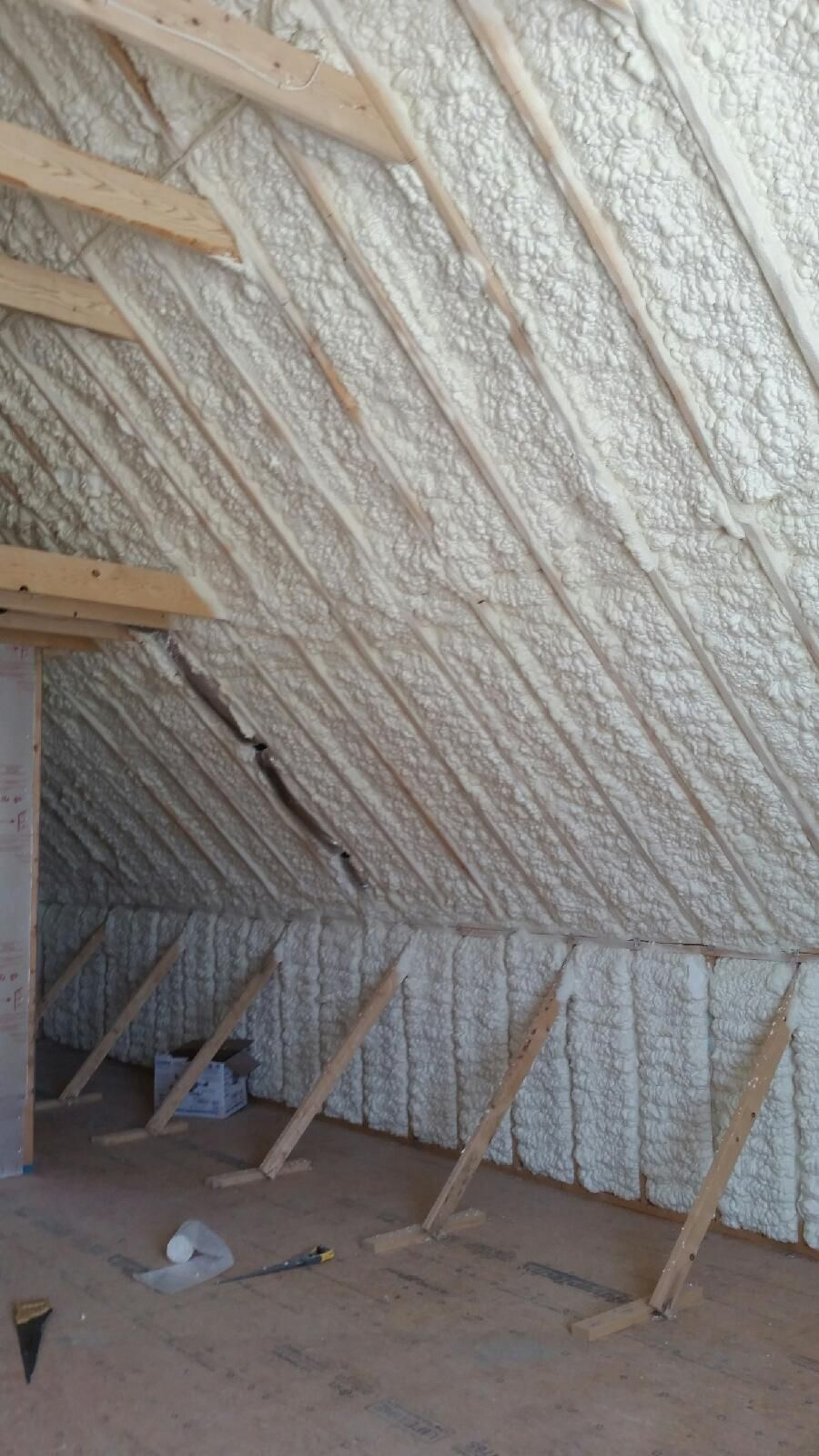Open Cell Spray Foam Insulation Installed On The Roof Deck And Knee Walls At A New Townhouse Spray Foam Attic Insulation Spray Foam Insulation Foam Insulation