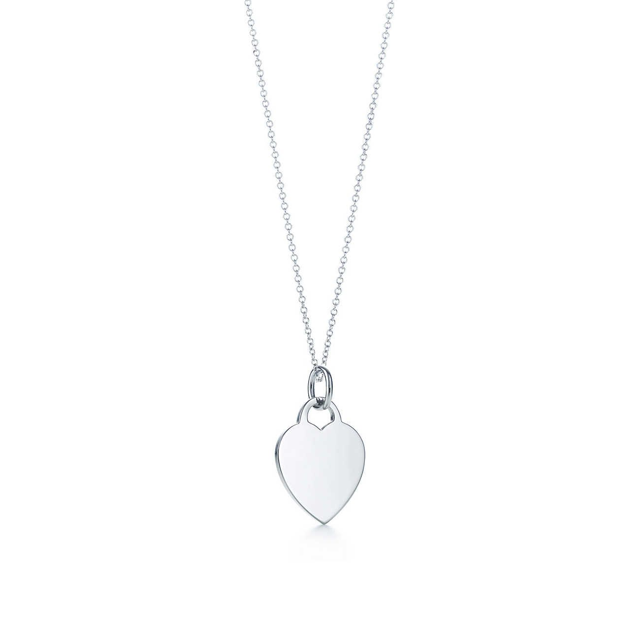 Heart tag charm in sterling silver on a chain.