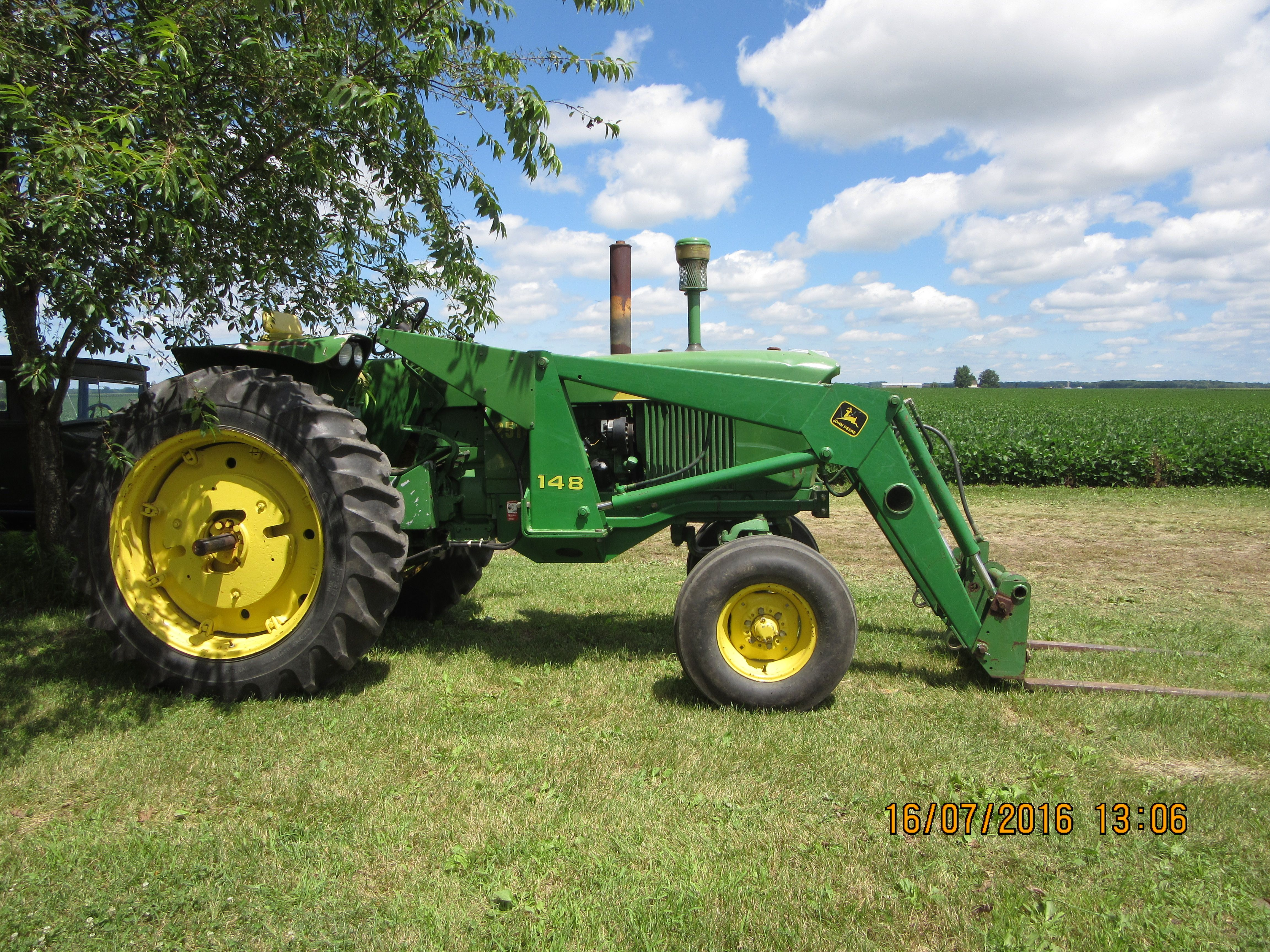 Rightside of John Deere 2510 equipped with 148 loader