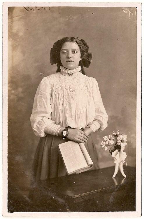 66cb97f8a24 Woman c. 1910 wearing a wrist watch...so weird