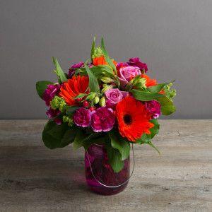 Bright cerise arrangement in a gorgeous coloured jar