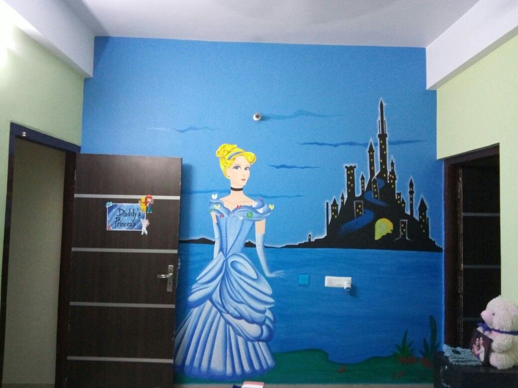 Painted a castle on my wall,  created a princess on cardboard and pasted it on the wall. Easy and fun!!