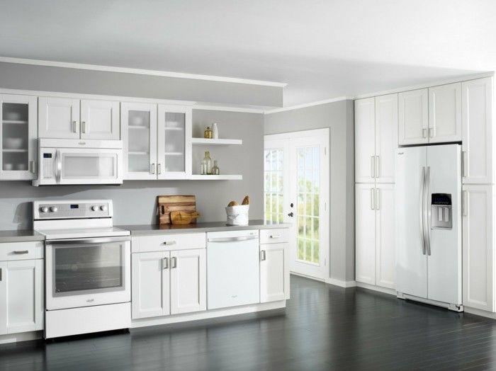 moderne offene Küche in L Form, graue Küchenwand, schwarzer ...