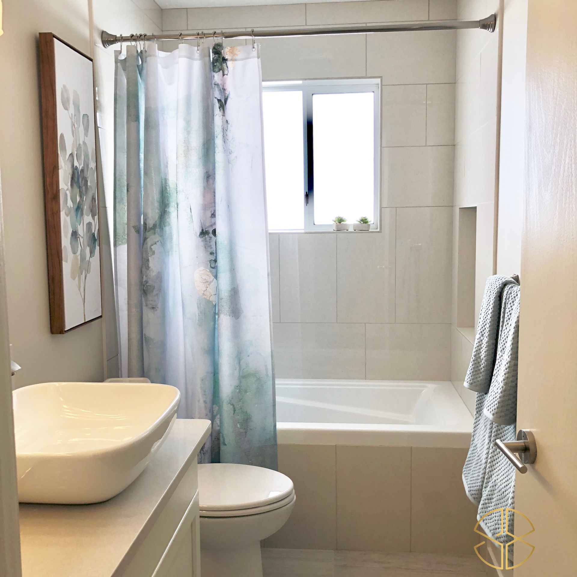 neutral bathroom with water colour accents in 2020