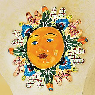 Mexican Talavera Sun    The distinctly Mexican pottery called talavera traces its origins to Spanish majolica, which itself grew out of tin-glazed ceramics introduced by the Moors. Today, the Mexican village of Dolores Hildago is one of a handful of regions known for their talavera. Artisans in open studios along the Calle de Puebla create the high-fired terra-cotta forms, apply white underglaze, and finish with colorful patchwork designs.  Indoors or outside.    National Geographic