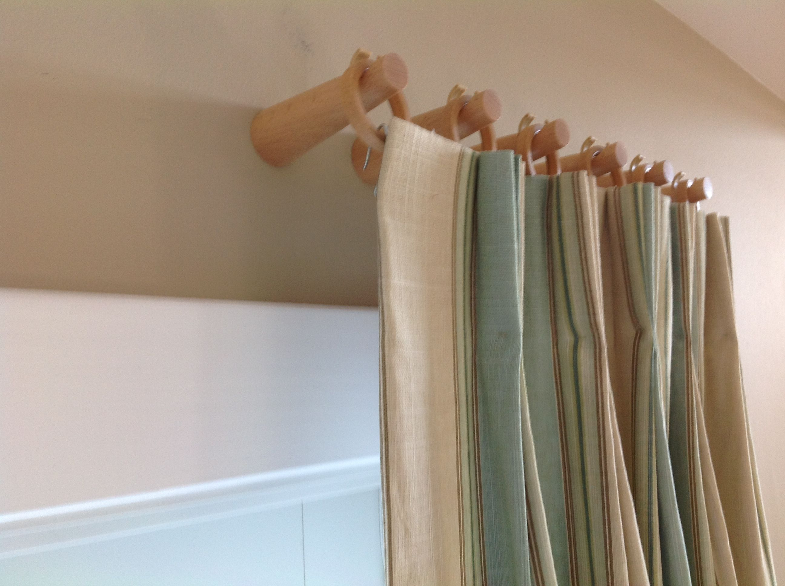 Instead Of Drapery Rods Use Wooden Pegs And Rings To Hang Your