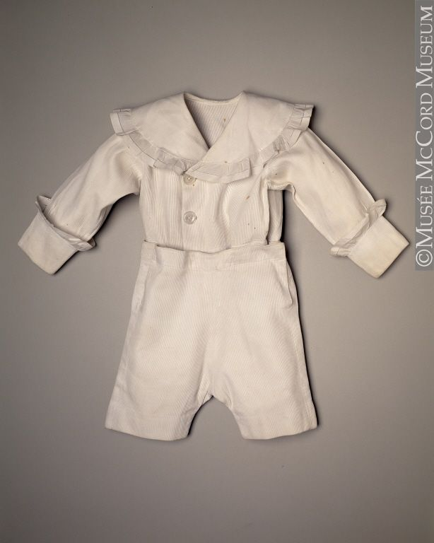 1917. This type of child's outfit was very popular in the early 20th century. At that time, every young lad of a certain social standing had to have one something like it. Although boys had previously worn long dresses, they were now wearing short pants known as knickers, which were easier to wear when learning to walk. White was particularly prized as a colour; it signified the purity of the soul.