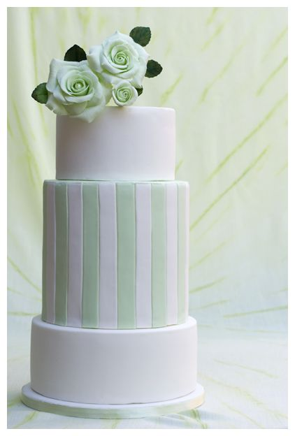 White and mint green rose wedding cake