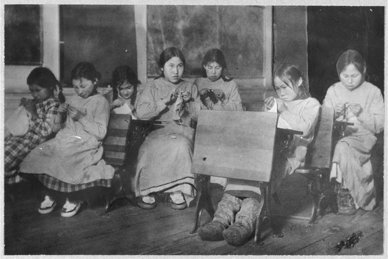 Eskimo children learning to sew in a U.S. government ...