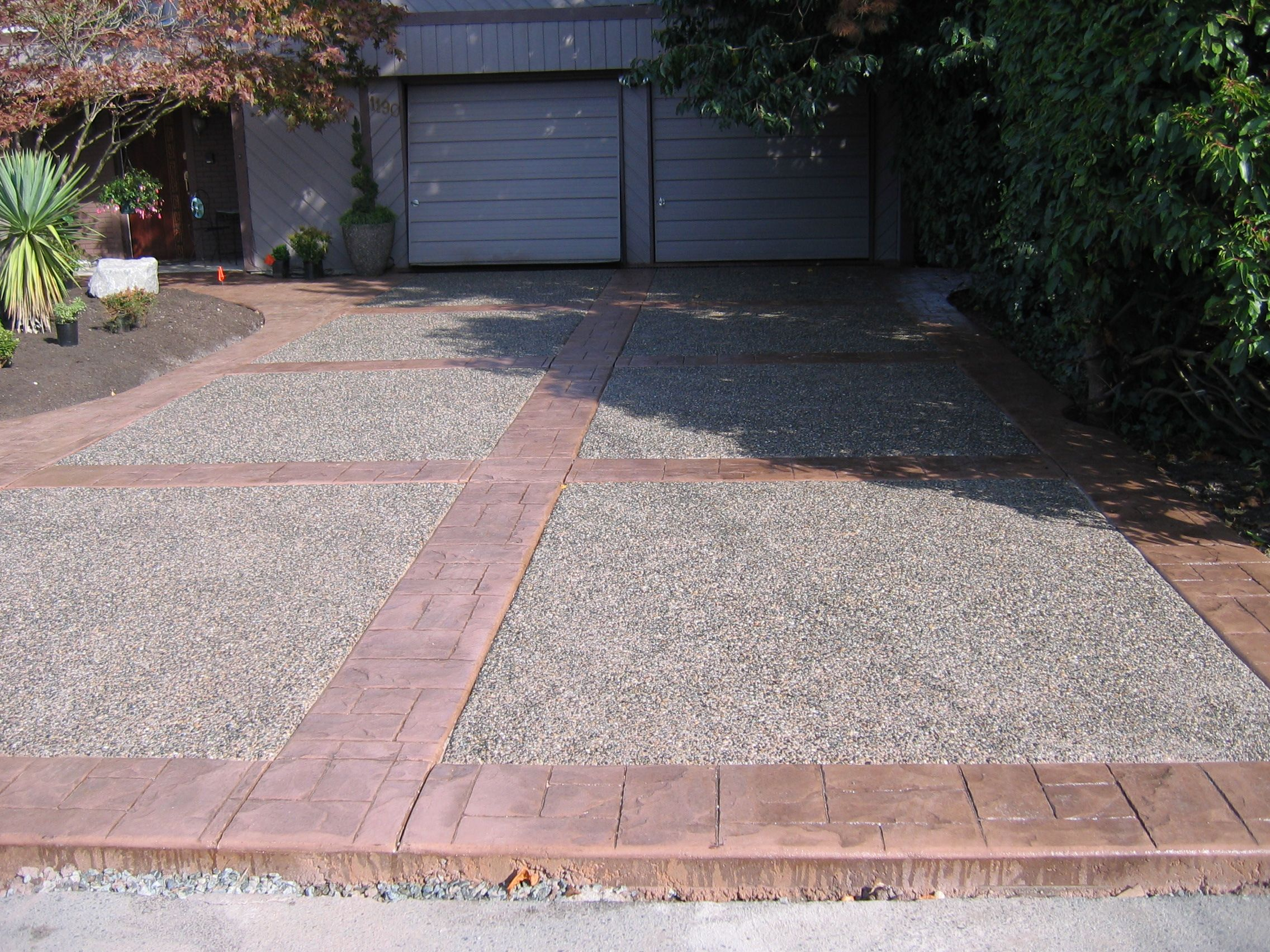 Stamped colored concrete with exposed aggregate driveway for Cement driveway ideas