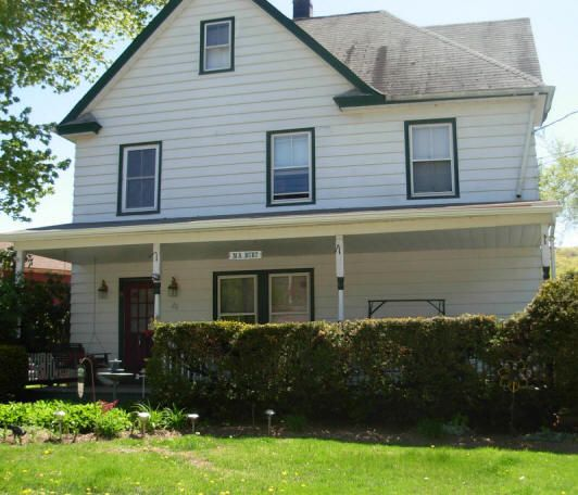 """This house is the same today as it was in 1950 including the sign """"MS Burt.""""  It was the home of my kindergarten teacher Mrs. Burt and her husband."""