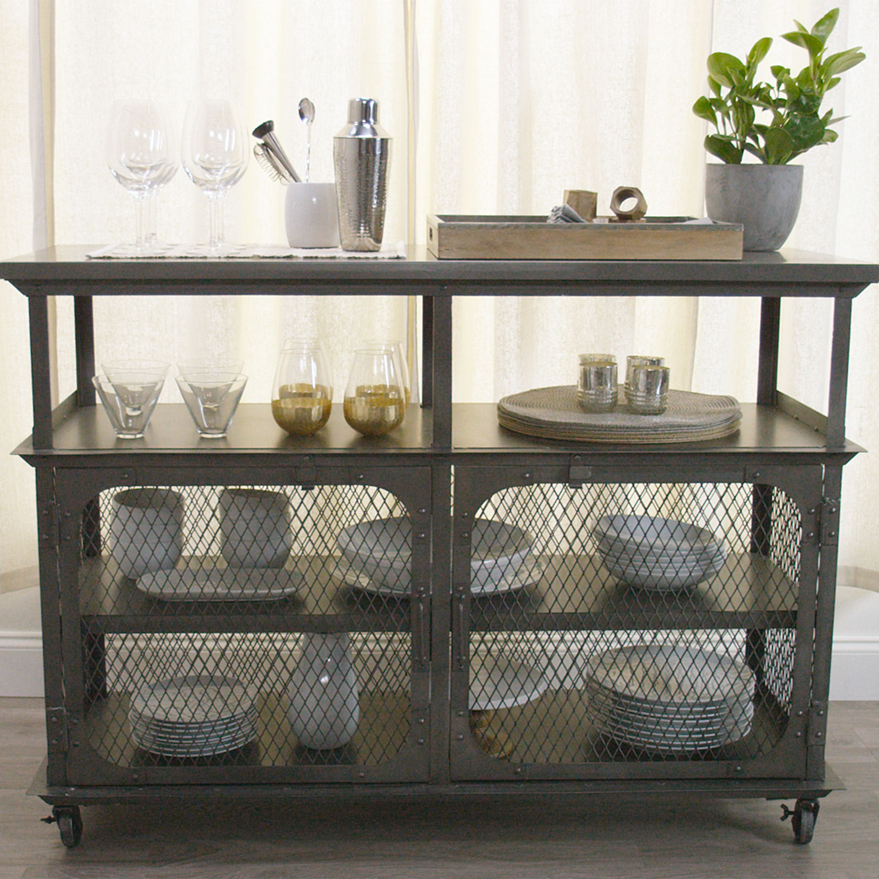 Exuding an industrial appeal our all-metal bar features locking caster wheels and &le storage with two large shelves behind cage doors. & Exuding an industrial appeal our all-metal bar features locking ...