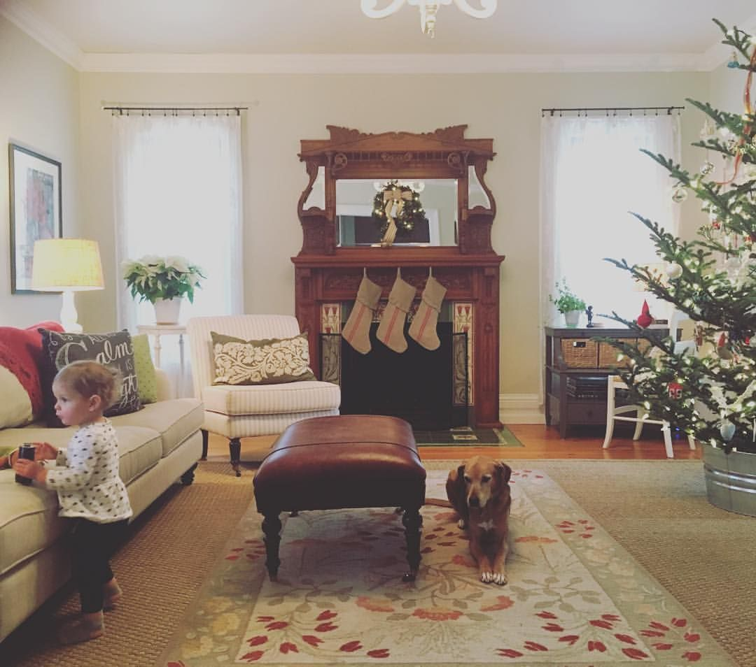 Living room at Christmastime.  Victorian fireplace, lace curtains, layered rugs, pine floors.  Neutrals.  Ballard Design furniture.  Benjamin Moore overcast.