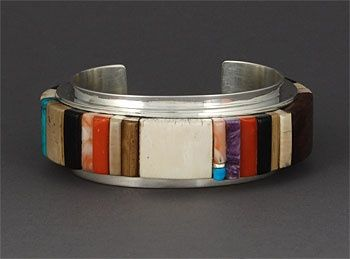 Edison Cummings (Navajo) | Sterling silver cuff bracelet set with ironwood, fossilized ivory, coral, turquoise, Charoite, and spiny oyster
